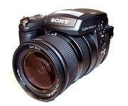 Продам профессиональный фотоаппарат Sony R 1, в упаковке со вспышкой